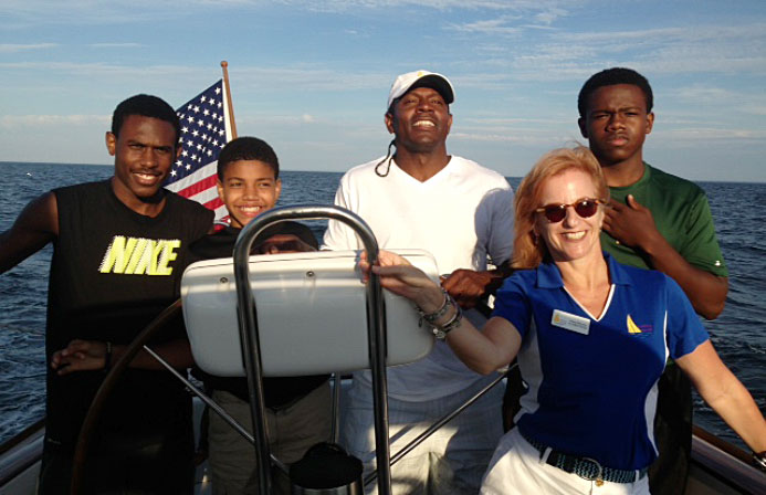 New England Patriot Legend Troy Brown and family enjoy a healing sail with Executive Director Trisha Gallagher Boisvert