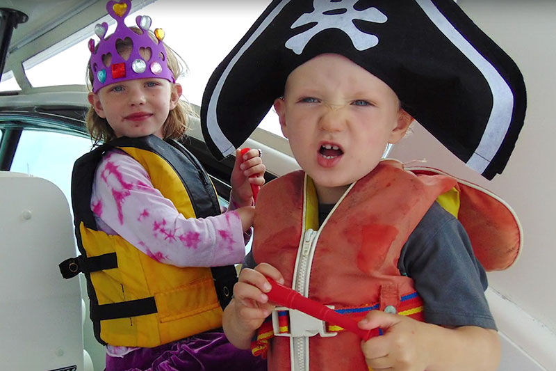 Young girl and boy dressed as a princess and a pirate